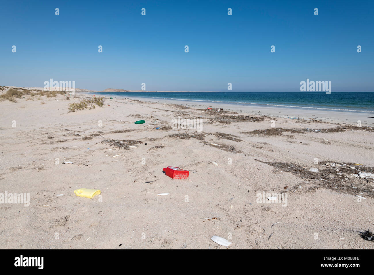 Garbage on the beach left on the beach by people and from the sea. Oman - Stock Image