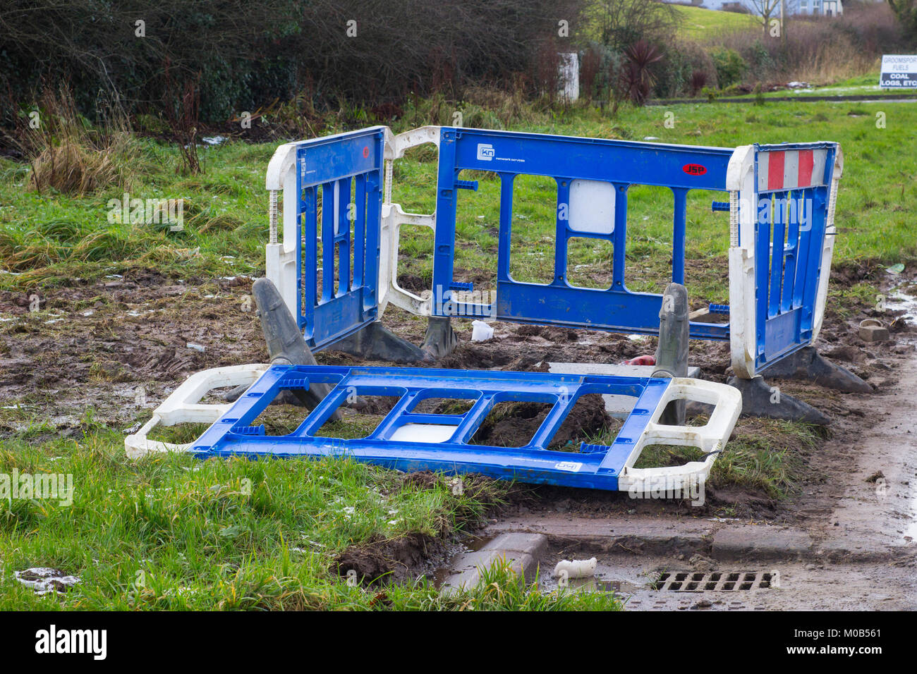 18 January 2018 Construction site safety barriers erected around a neglected and waterlogged utilities excavation - Stock Image