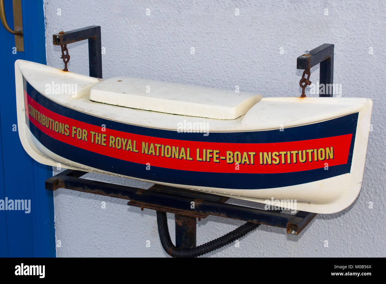 An RNLI donation box hanging outside the offices in Donaghadee in County Down Northern Ireland - Stock Image
