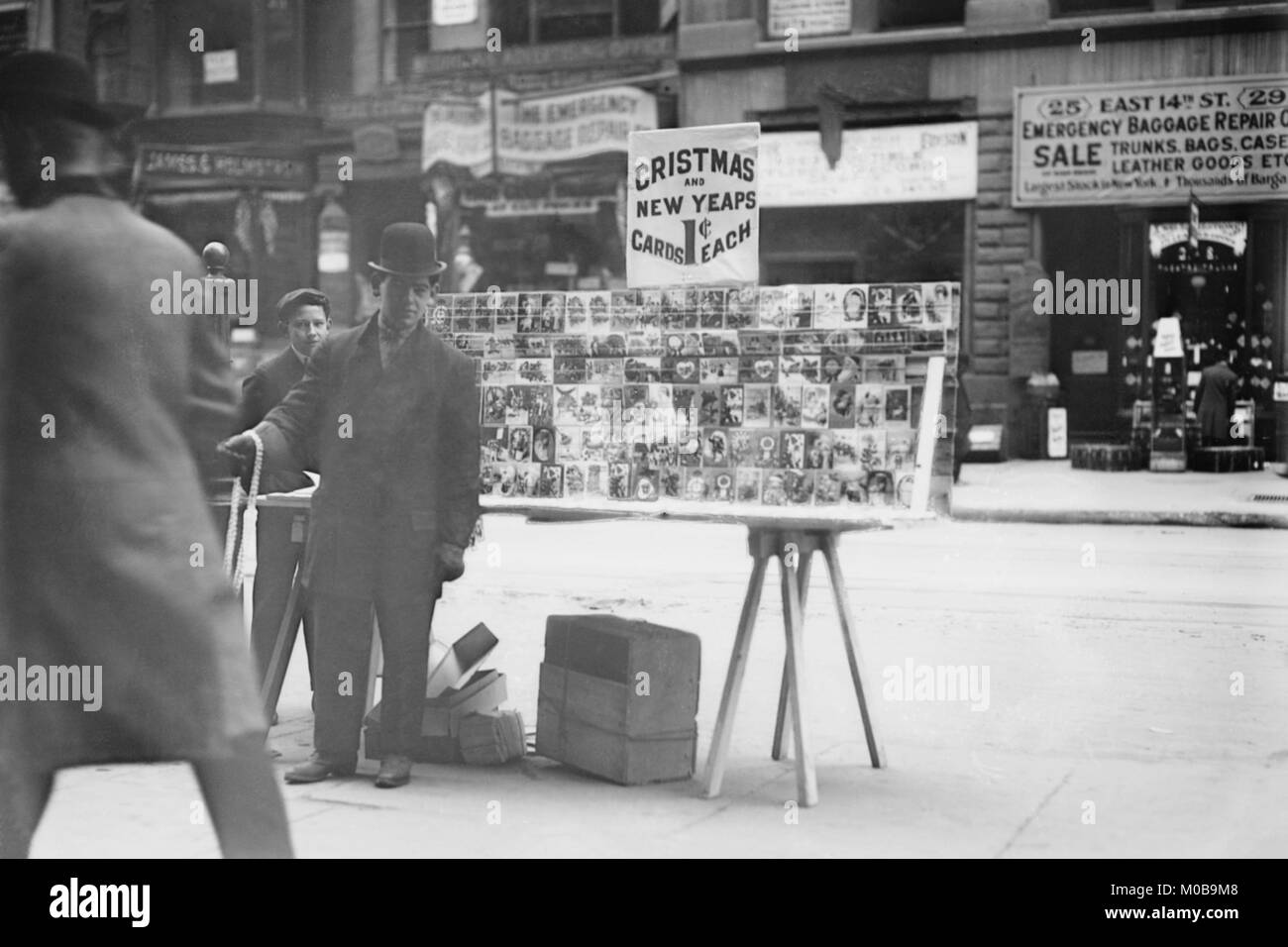 Street Vendor Sells Christmas & New Years Cards of New York Street - Stock Image