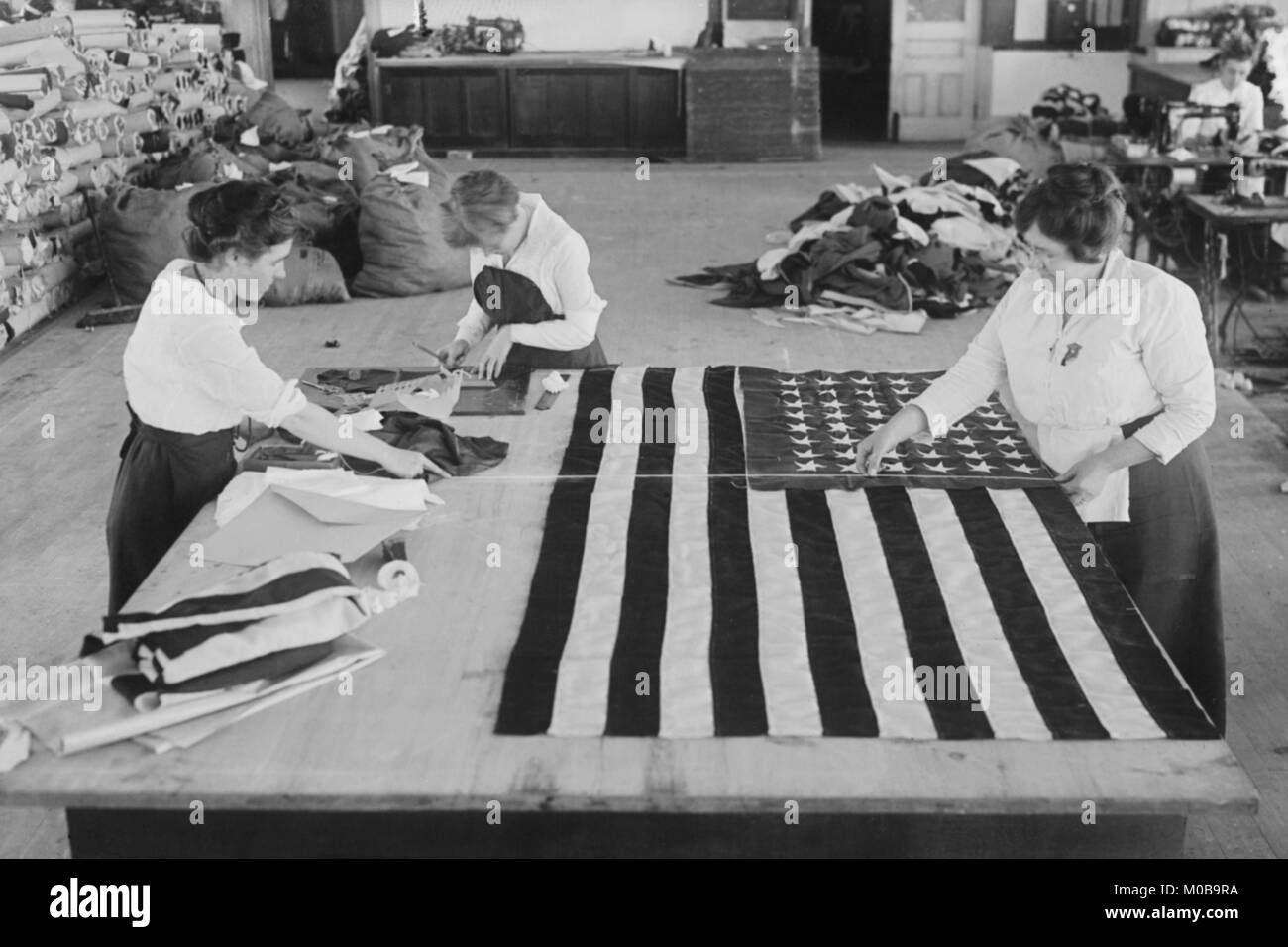 Sewing the Flags of the Great War - Stock Image