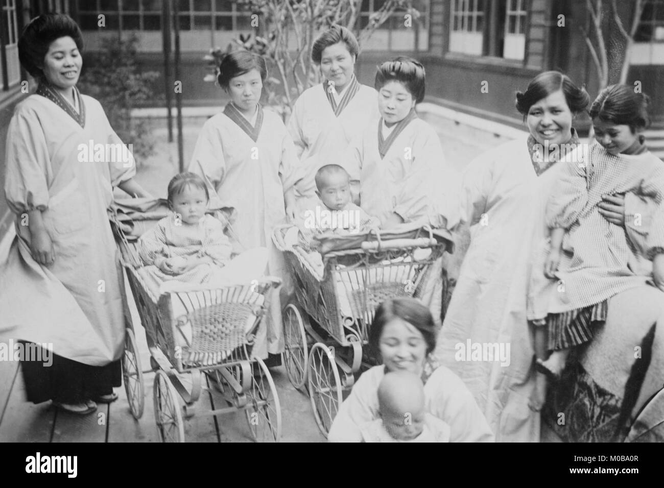 Japanese Mothers with their infants in Perambulators or Baby Carriages - Stock Image