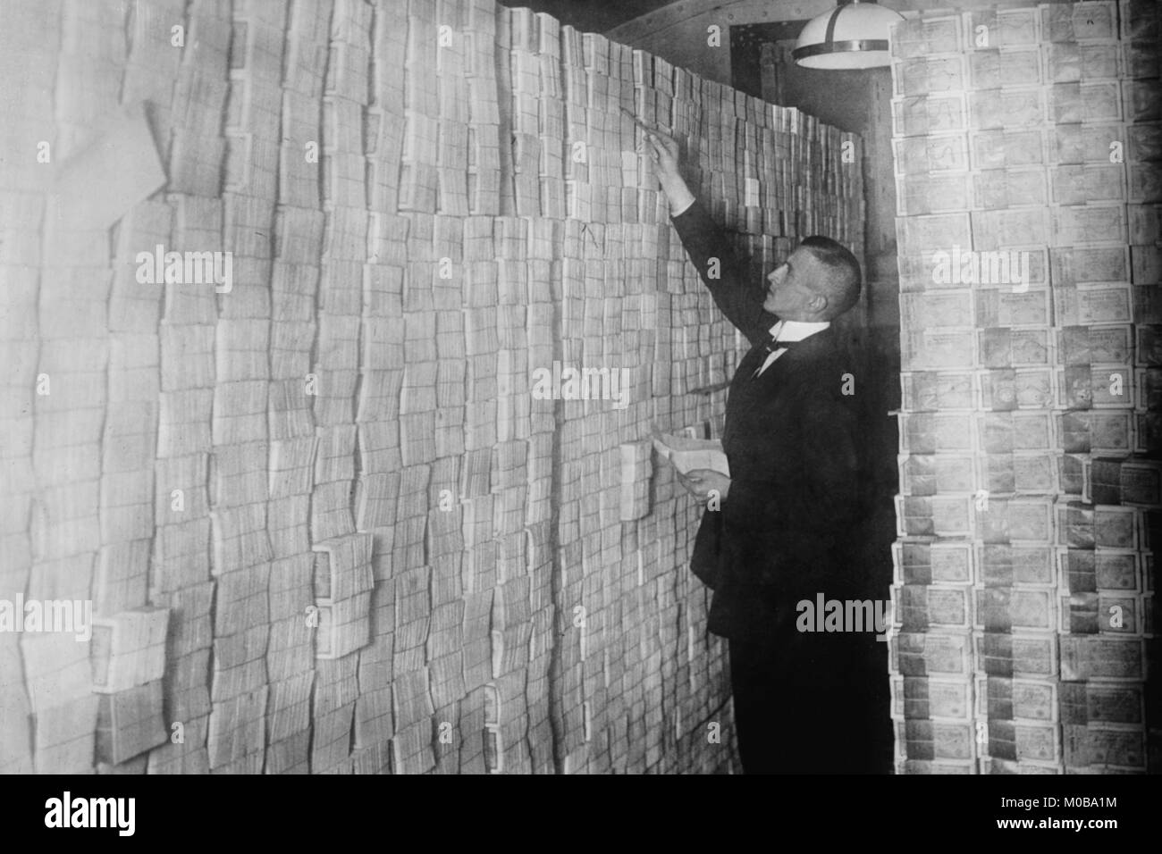 Inflation in Weimar Germany has paper money stacked from Floor to Ceiling in a Berlin Bank - Stock Image