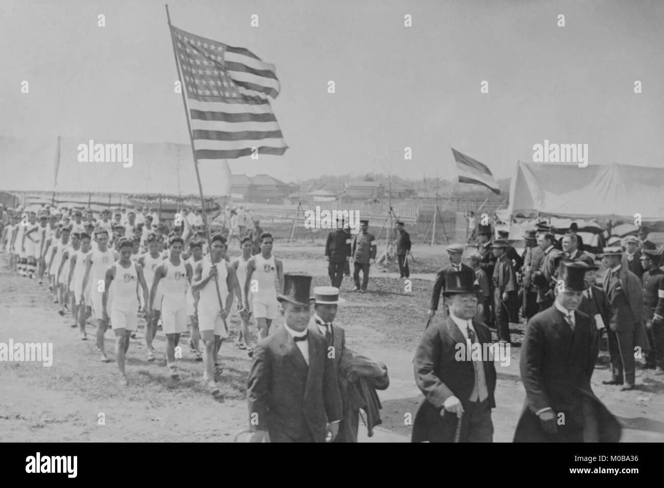 American & Filipino Athletes March Behind Japanese Dignitaries - Stock Image