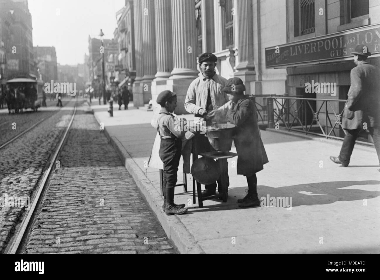 Boys buy peanuts from Street Vendor of 42nd street. NYC - Stock Image