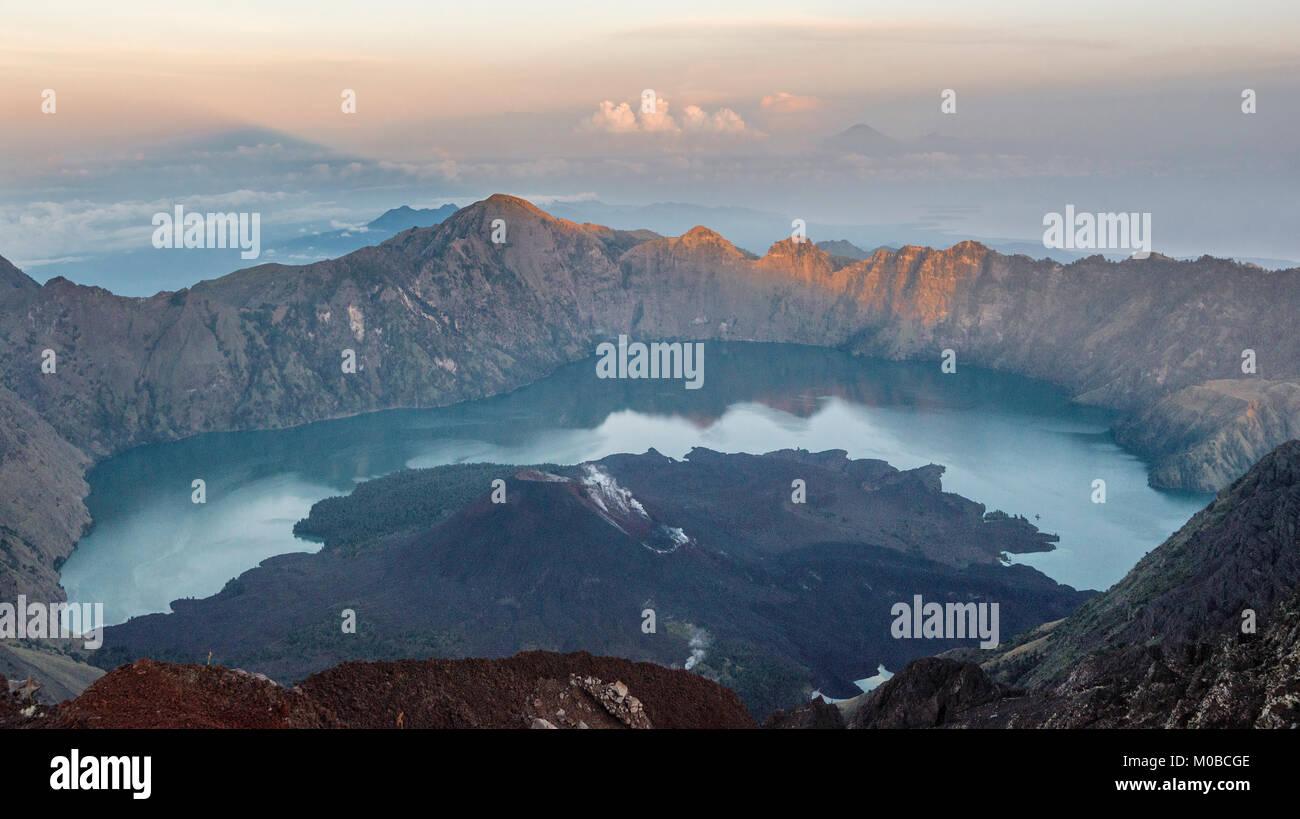 Sunrise view of Mount Rinjani and crater lake, Lombok, Indonesia - Stock Image