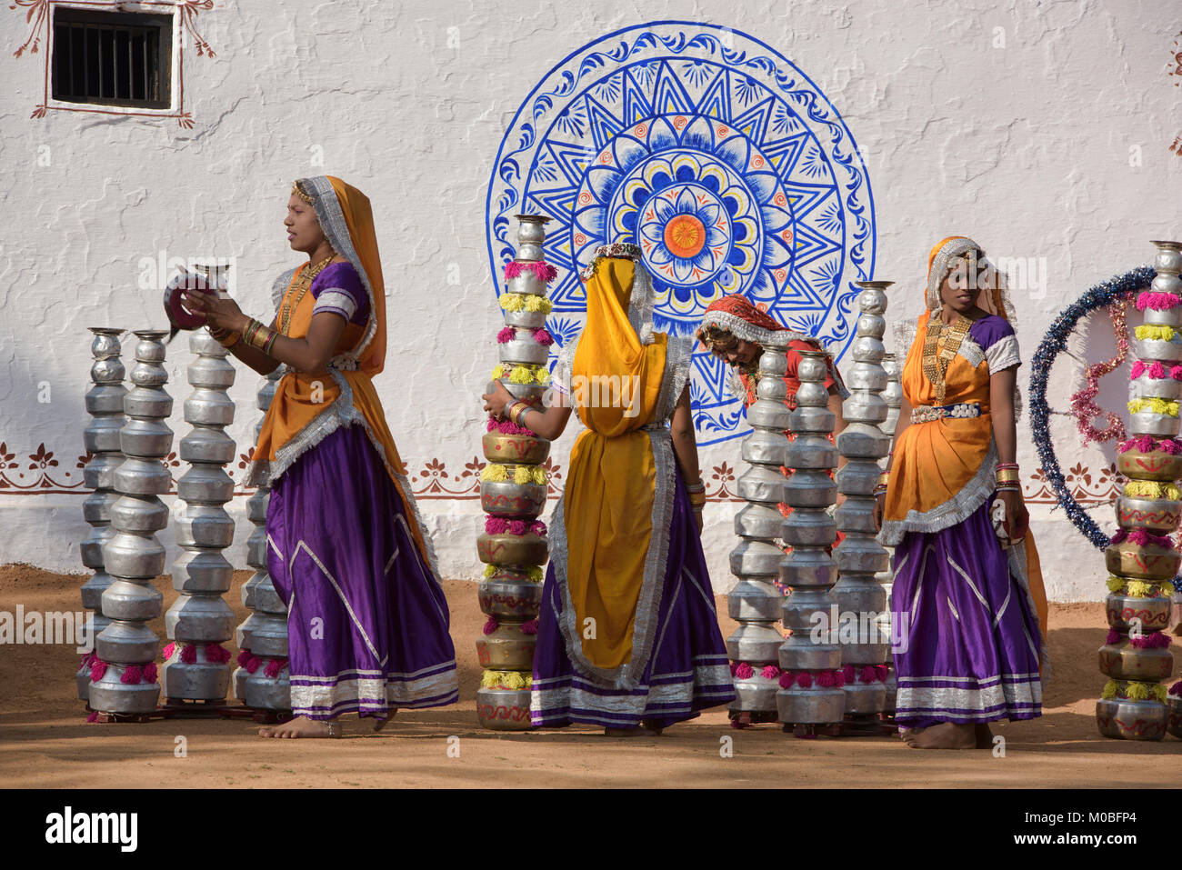 Women prepare to perform the Bhavai pot dance from Rajasthan and Gujarat, celebrating women's efforts to carry - Stock Image
