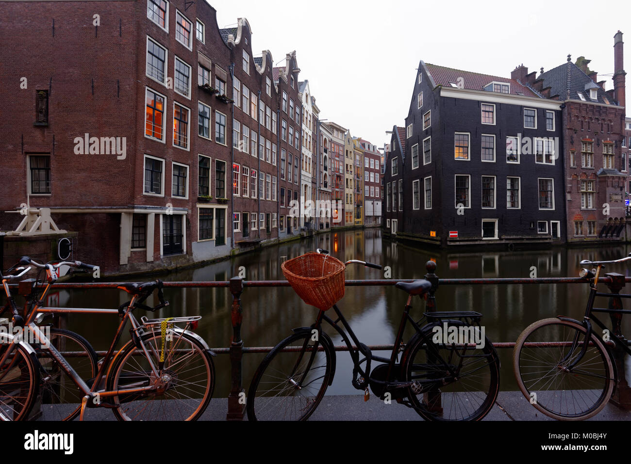 Amsterdam, Netherlands - January 1, 2017: One of canals in the historical part of city. The 17th-century canal ring - Stock Image