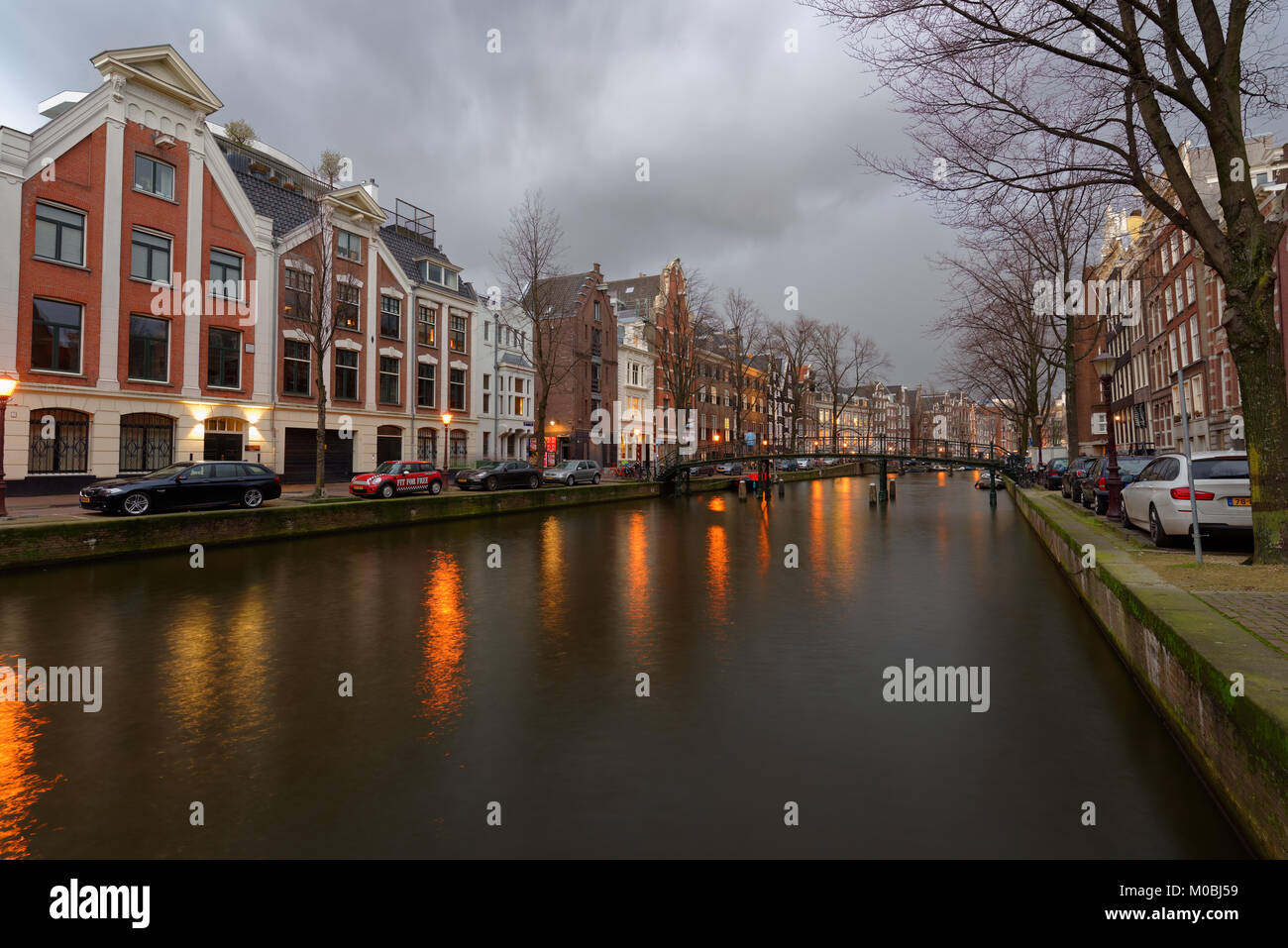 Amsterdam, Netherlands - January 2, 2017: One of canals in the historical part of city. The 17th-century canal ring - Stock Image