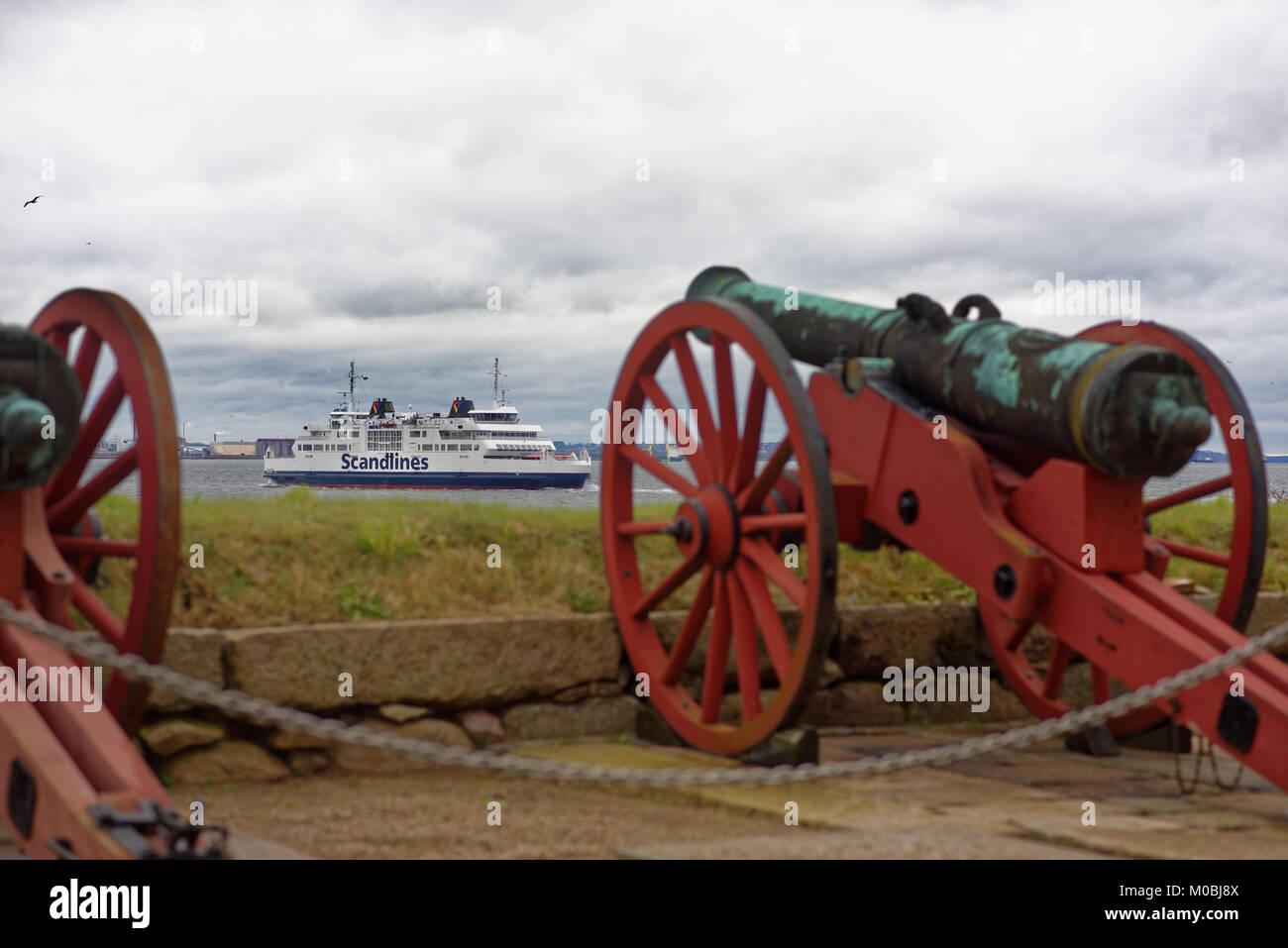 Helsingor, Denmark - November 6, 2016: Ferry line between Denmark and Sweden under protection of old guns of Kronborg - Stock Image