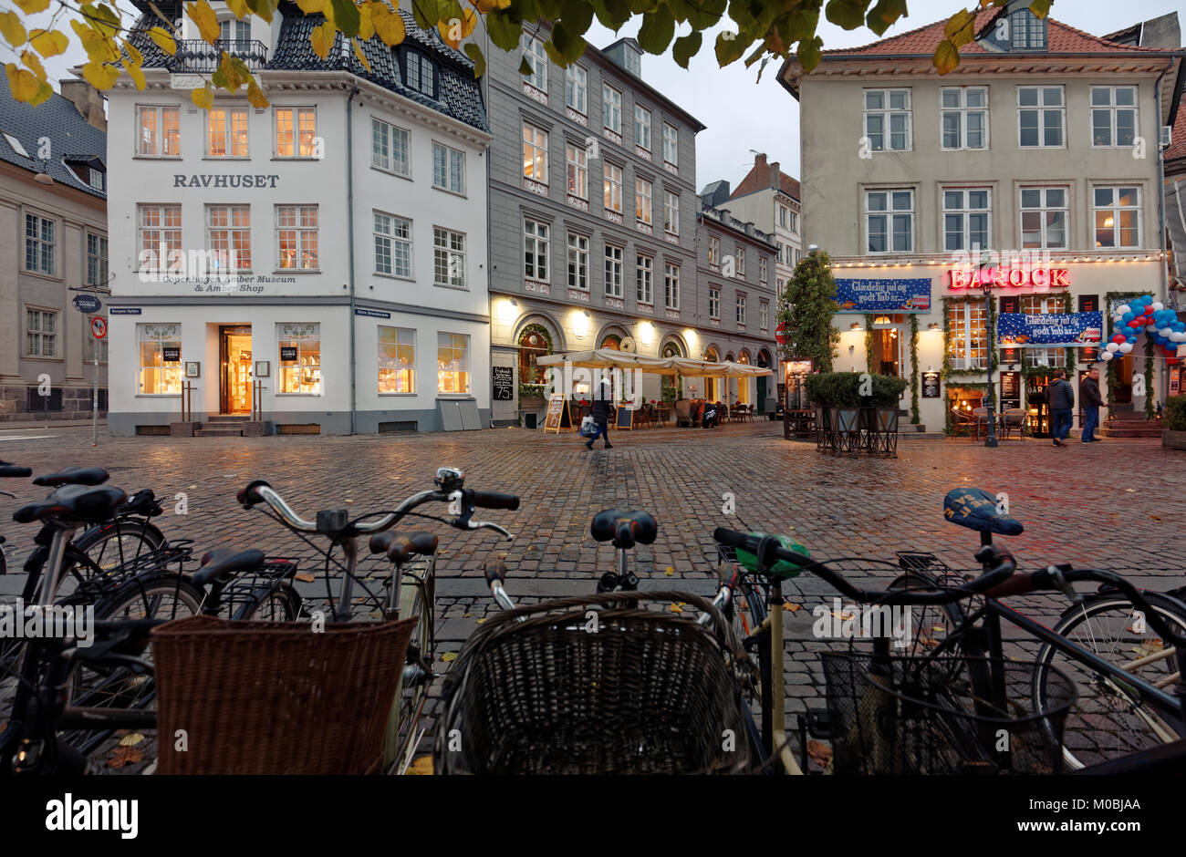 Copenhagen, Denmark - November 6, 2016: Bicycles and people on Kongens Nytorv square. The largest square of the - Stock Image