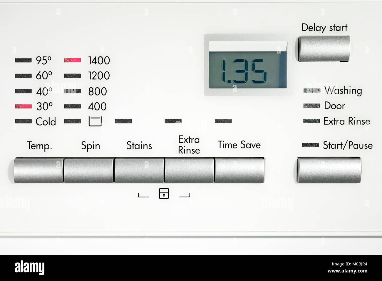 Washing machine set to 30 degree wash and 1400RPM spin speed 1hr 35min 1.35hrs - Stock Image