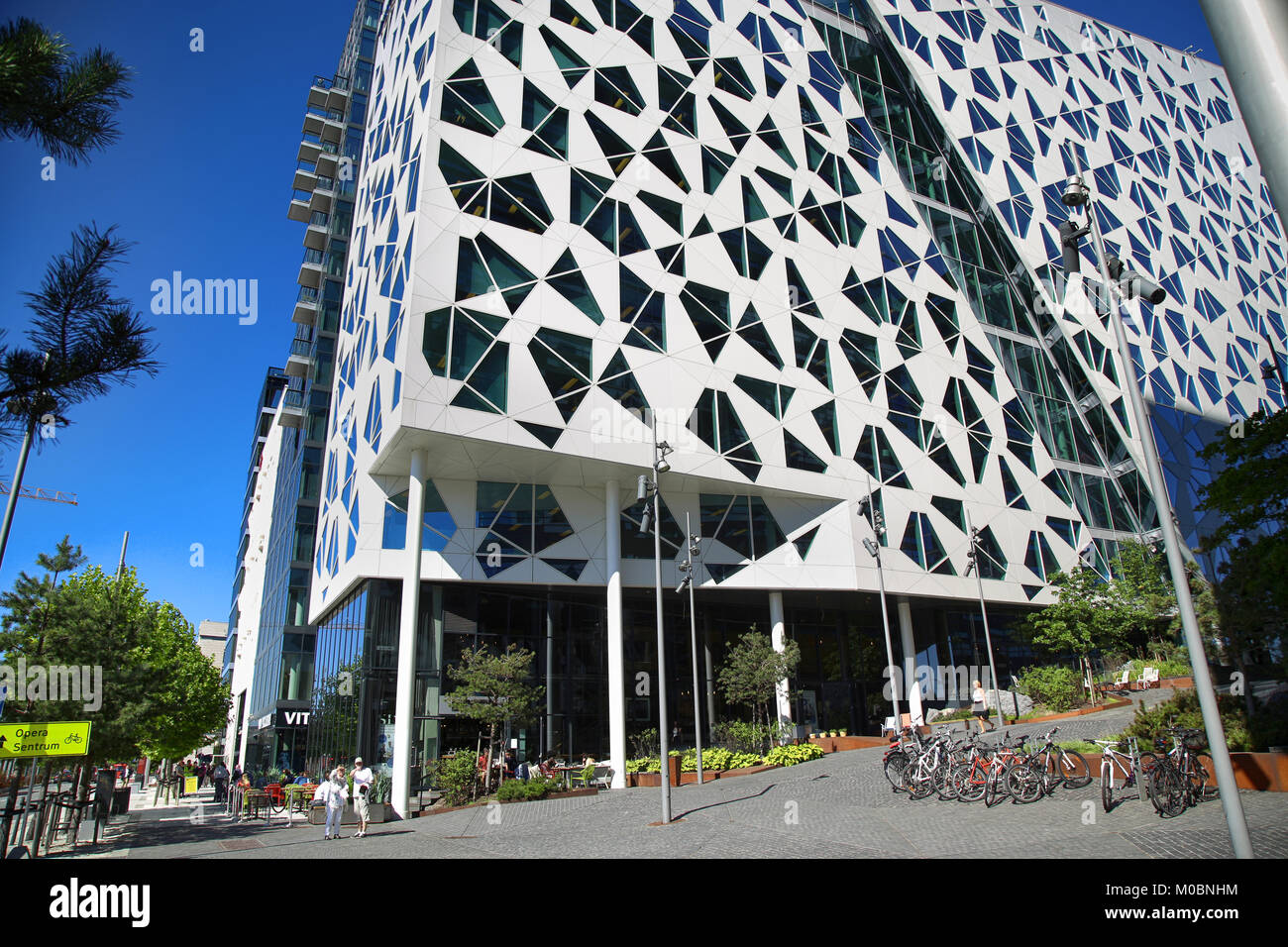 OSLO, NORWAY – AUGUST 17, 2016: Exterior of a new apartment blocks 'Barcode buildings' and walkway on Dronning - Stock Image