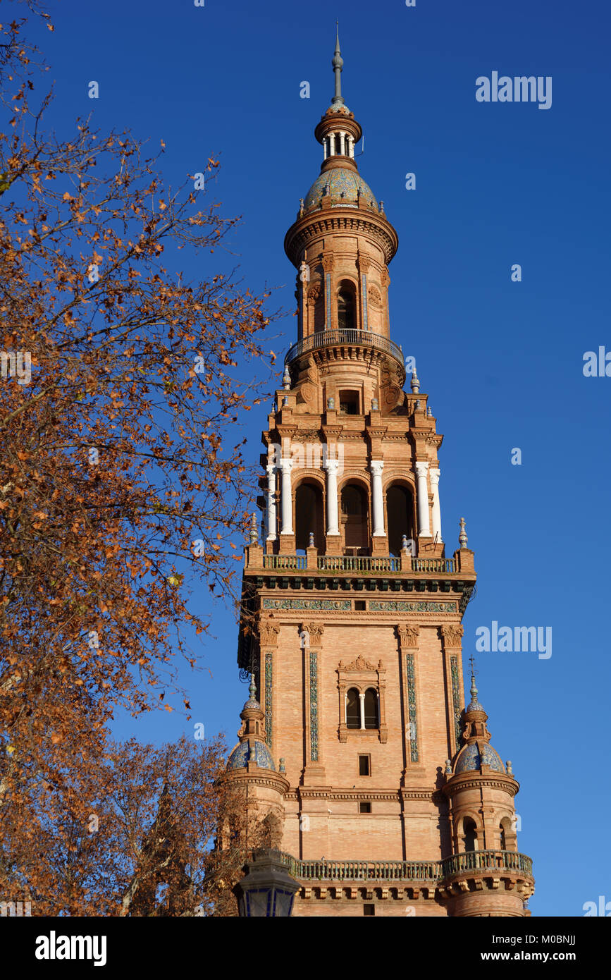 Seville, Spain - January 3, 2012: South tower of Plaza de Espana. Built in 1928, Plaza de Espana is a landmark example - Stock Image