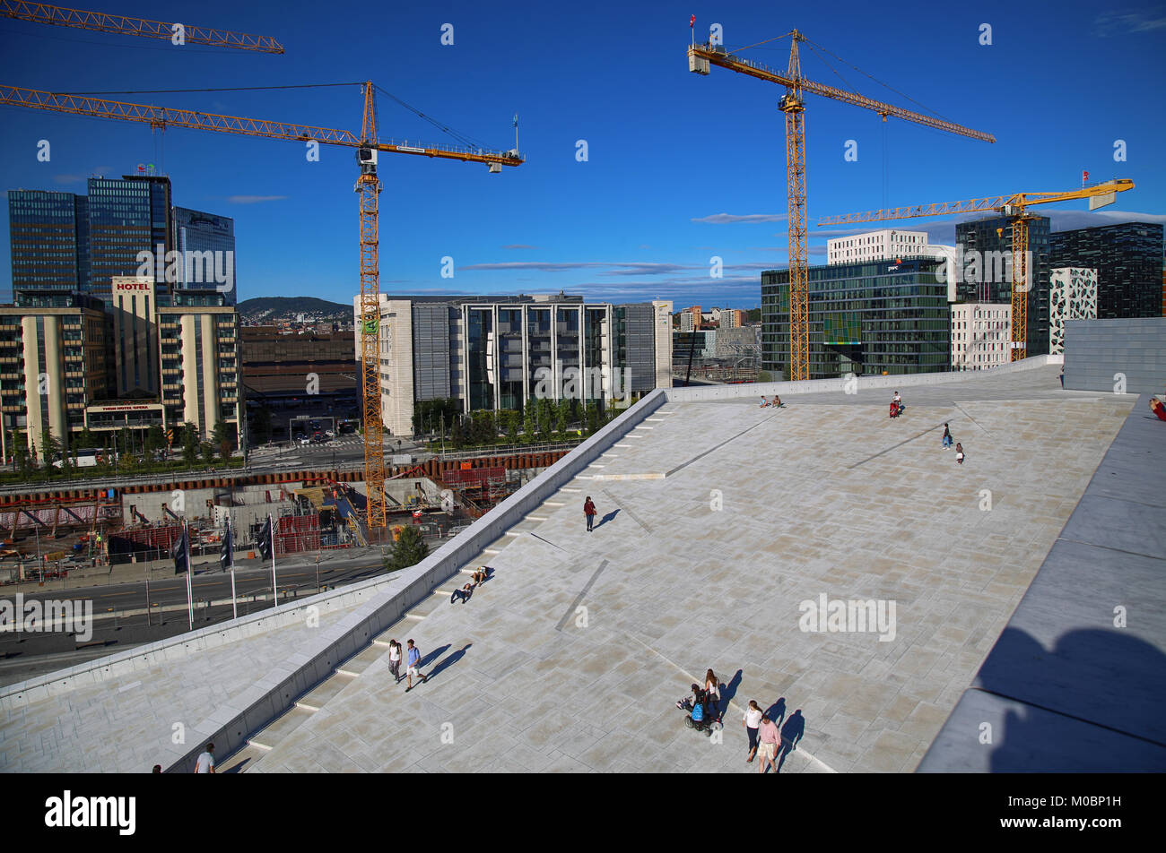 OSLO, NORWAY – AUGUST 17, 2016: View on Bjorvika and tourist on the Oslo Opera House which is home of Norwegian Stock Photo
