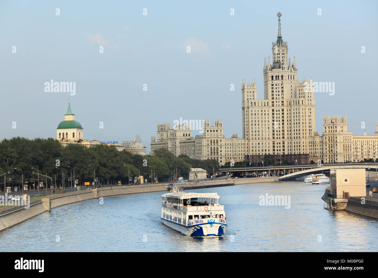 Moscow, Russia - July 31, 2010: Trip boat on Moscow river against one of Seven Sisters in Moscow, Russia on July 31, 2010 Stock Photo