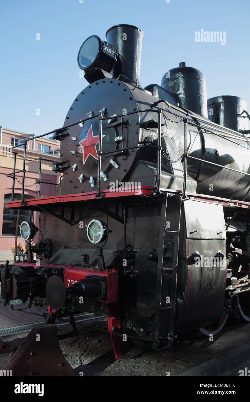 Steam Train black from soot, Railroad Station - Stock Image