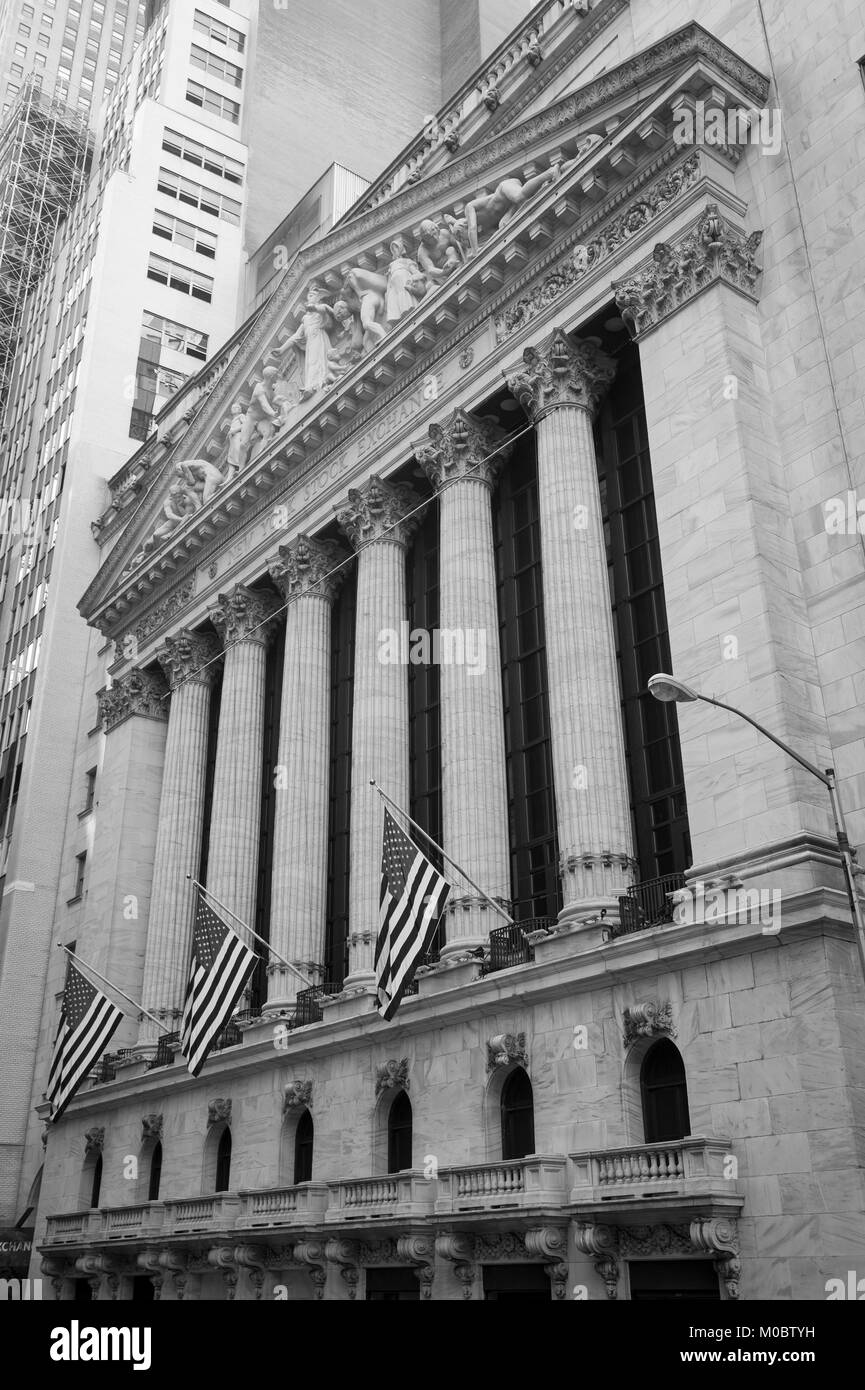 NEW YORK CITY - JULY 15, 2017: American flags hang from the facade of the New York Stock Exchange building, a Wall - Stock Image