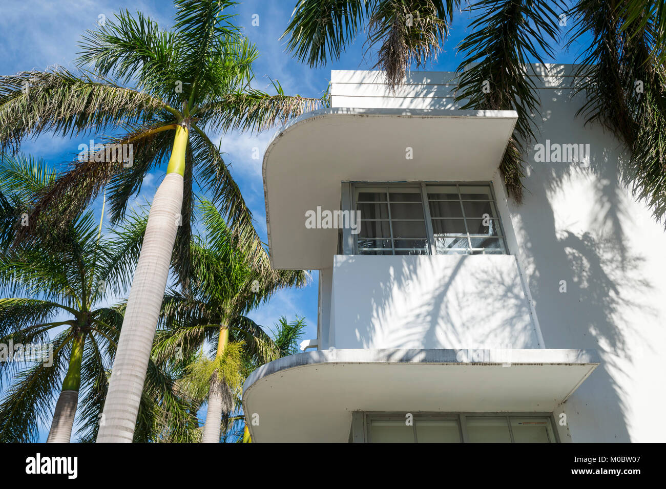Detail of classic Art Deco architecture with palm trees and blue sky in South Beach, Miami, Florida - Stock Image