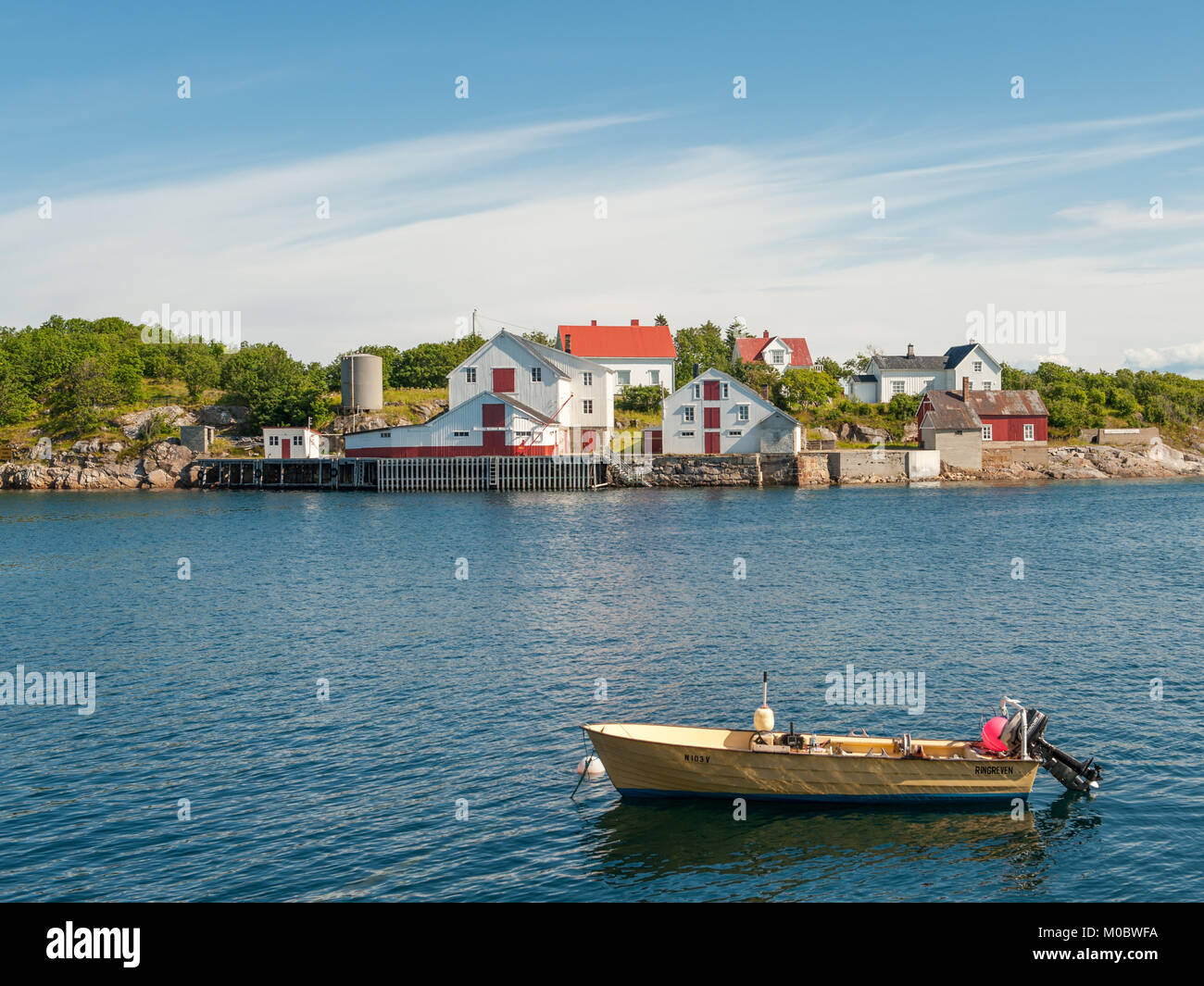 The harbor during summer in Henninsvaer. This is a popular tourist destination and a beautiful fishing village at - Stock Image