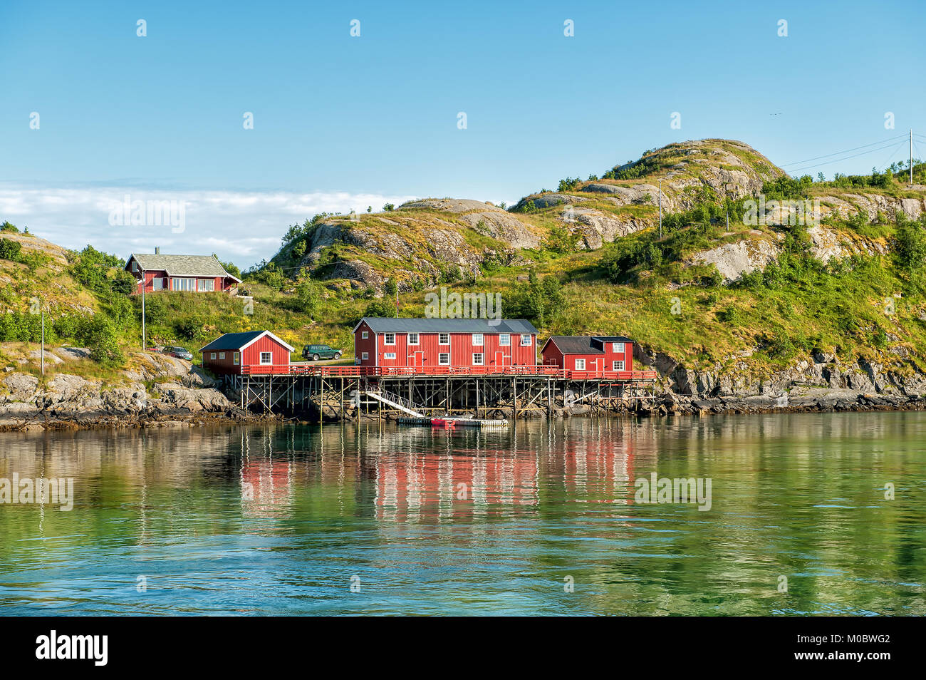Traditional rural buildings in coast landscape on Lofoten islands in northern Norway. Lofoten is a popular tourist - Stock Image