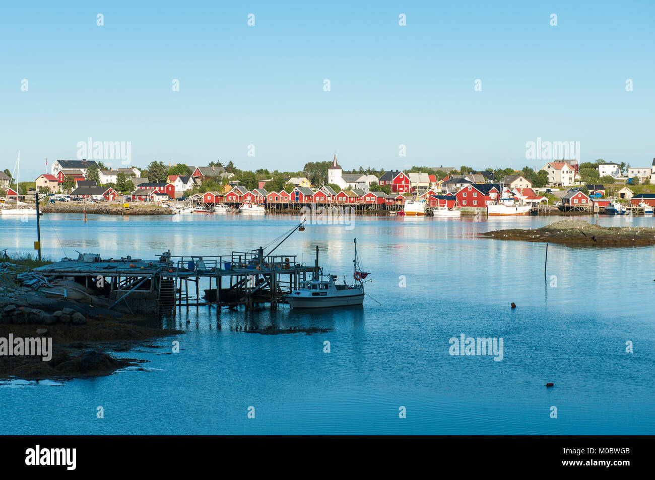 Nordic summer evening on July 4, 2011 in Reine. Reine is a picturesque fishing village and a popular travel destination - Stock Image