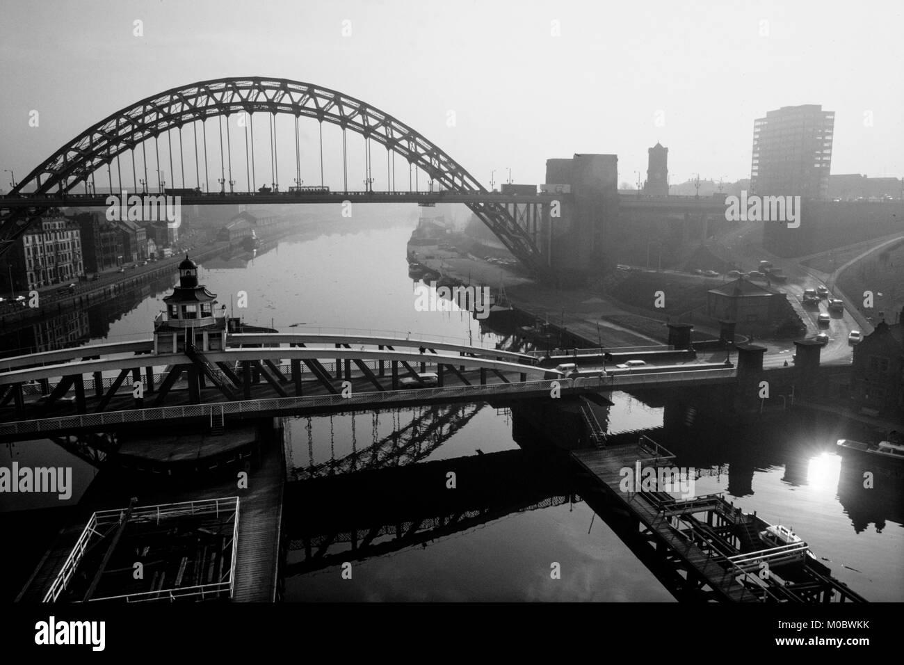 Newcastle upon Tyne,Tyne and Wear, England, UK. 1985 Tyne Bridge and Swing Bridge across the River Tyne looking - Stock Image