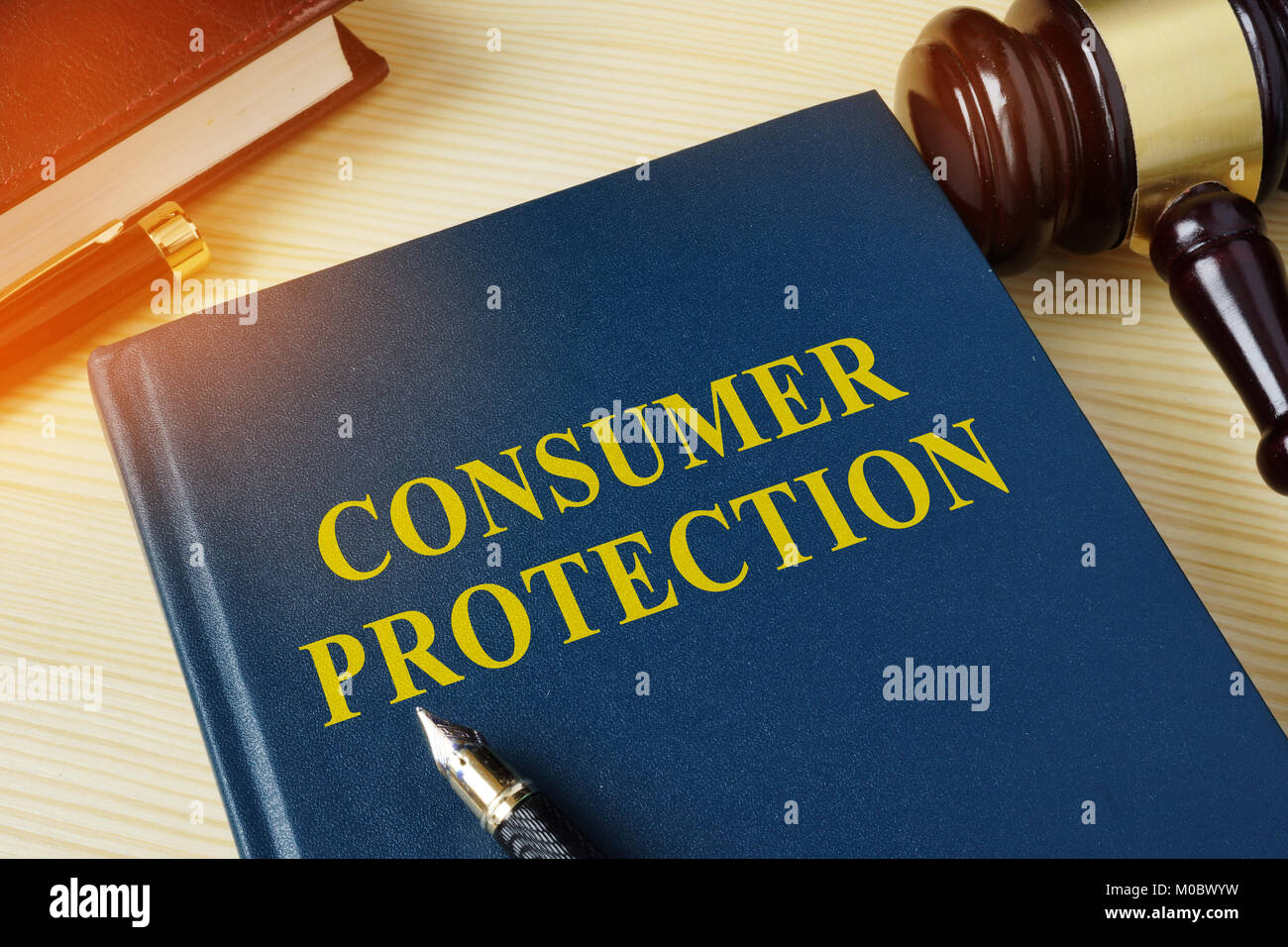 Book about Consumer Protection and gavel in a court. - Stock Image