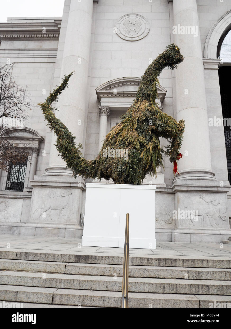 Christmas Tree Dinosaur outside The Natural History Museum, New York, USA. - Stock Image