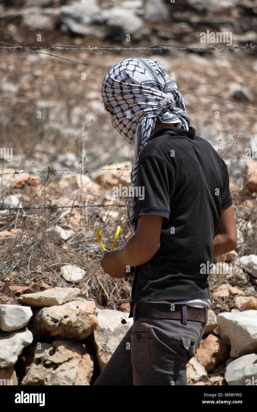 Israeli-Palestinian conflict. Clashes between Palestinian demonstrators and the Israeli army at Kafr Qaddum demonstration - Stock Image