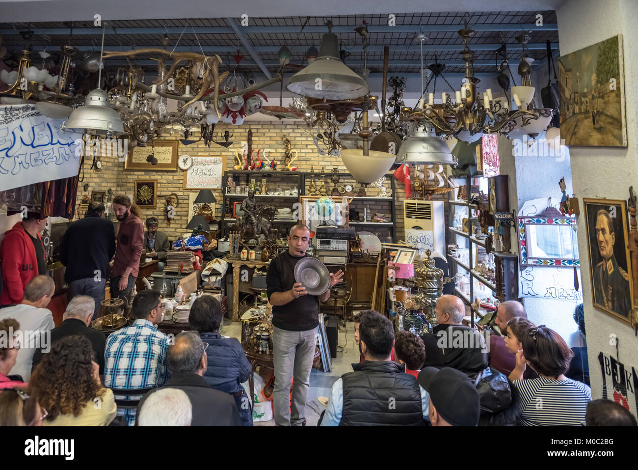 Unidentified man selling antique objects in auction shop in Balat,Istanbul,Turkey.15 October,2017 - Stock Image