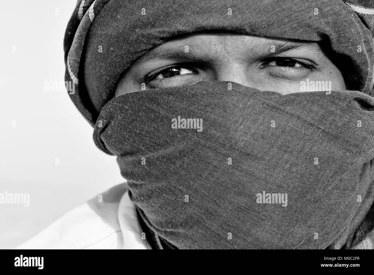 Arabic Men With Head Scarfs In The Desert Sunlight And Sand Stock Photo Alamy