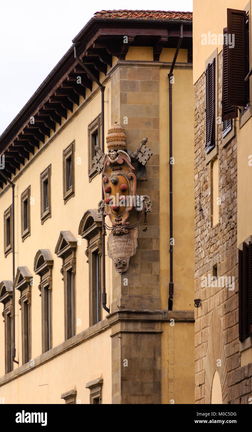 Large Ornage Crest on Old Building in Florence - Stock Image
