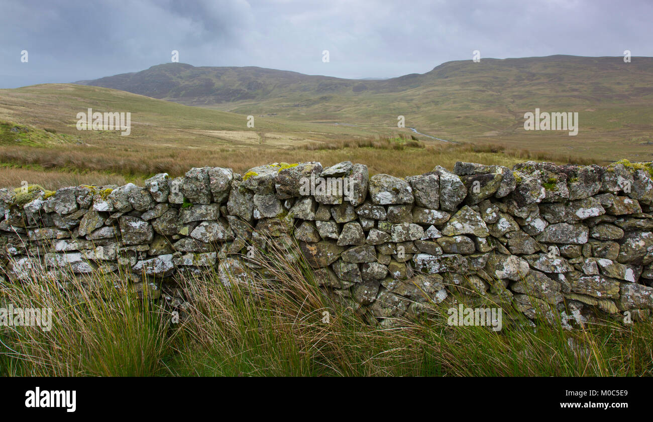 An old cobbled brick wall in the Snowdonia National Park, Wales. Stock Photo