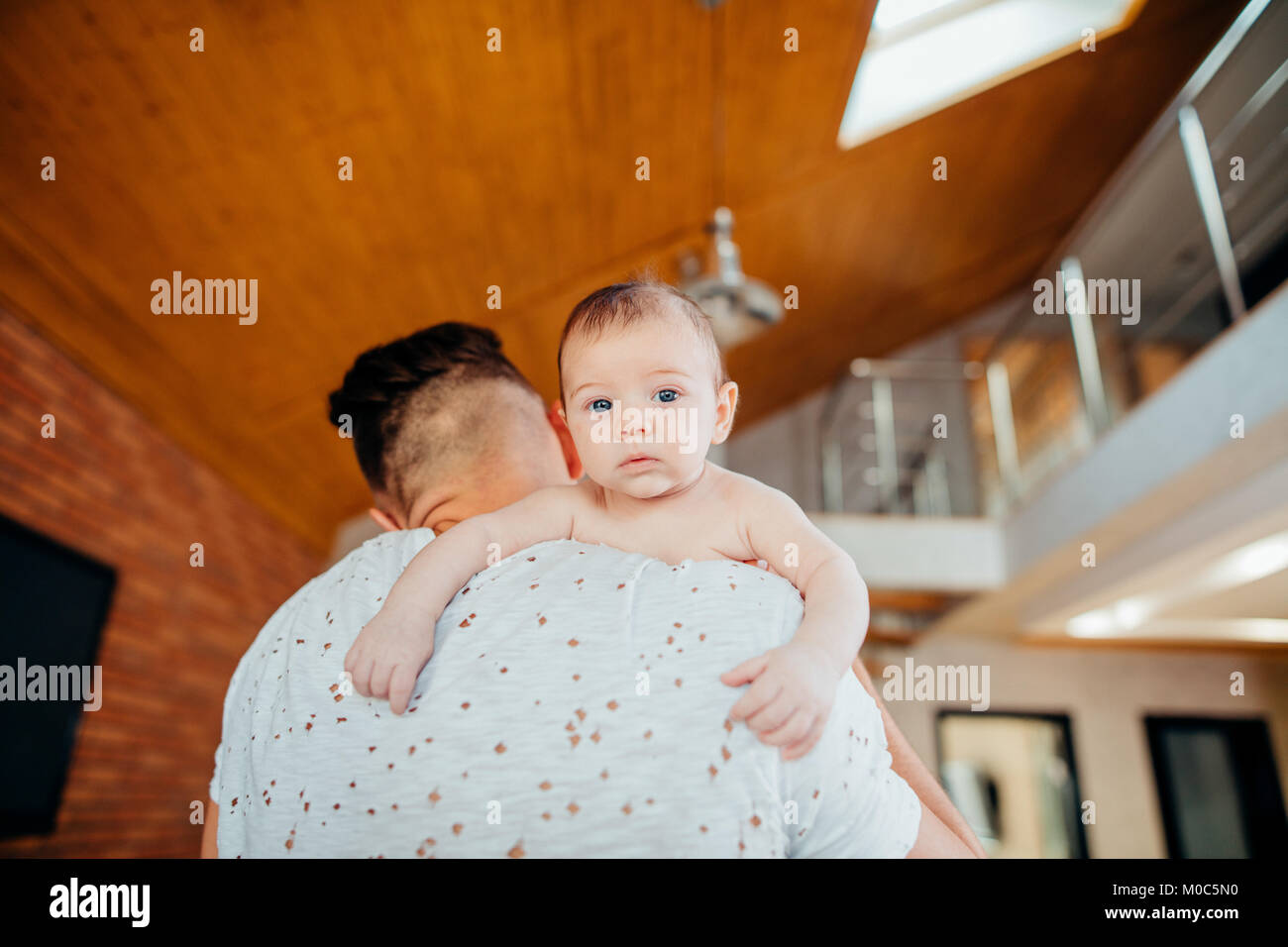 young father holding his newborn baby son Stock Photo