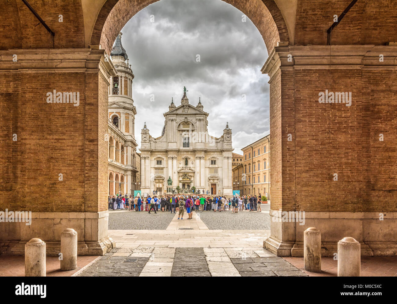 Sanctuary of the Holy House of Loreto, Marches, Italy, the Basilica facade with the Sisto V monument in the foreground - Stock Image
