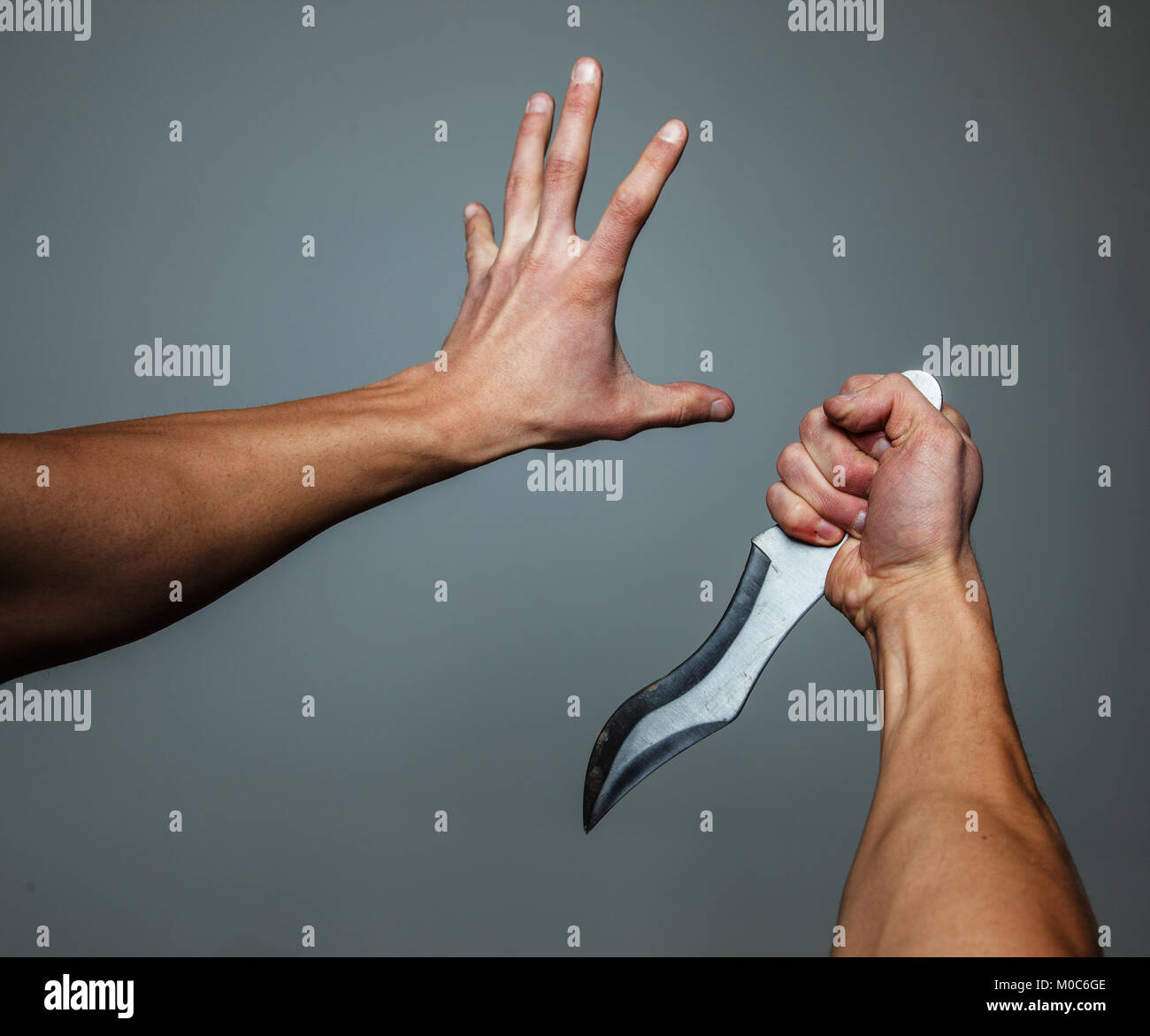 Arms with knife. Stock Photo