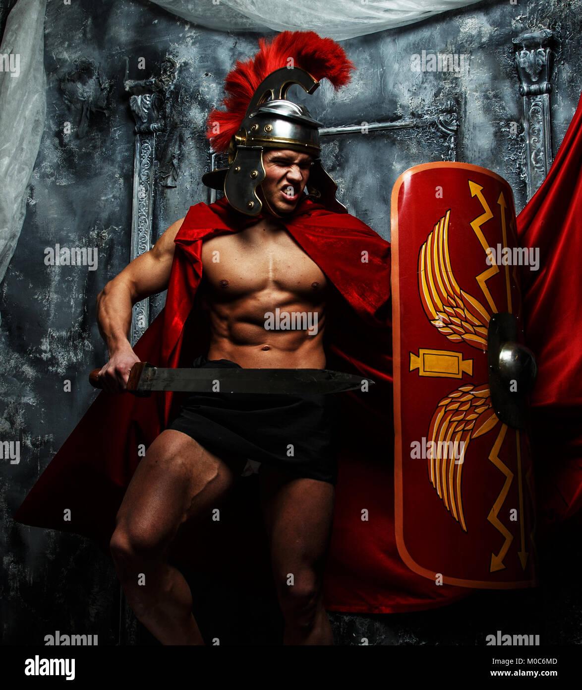 Muscular warrior attacks his enemies - Stock Image