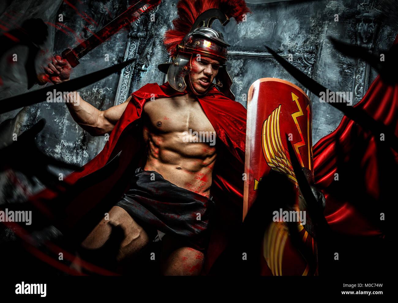 Roman warrior attacking his enemies - Stock Image