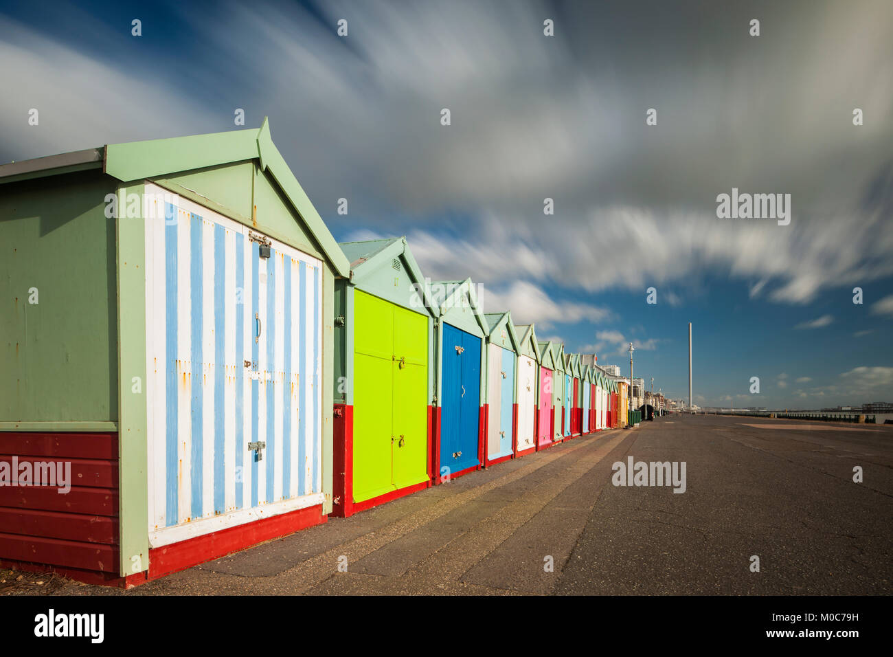 Iconic colourful beach huts on Brighton seafront, East Sussex, England. - Stock Image