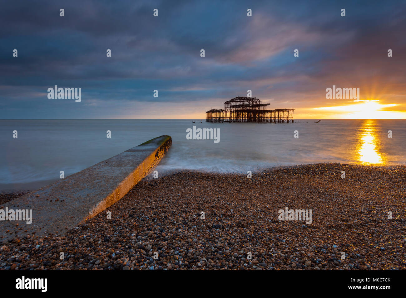Sunset at West Pier ruins in Brighton, East Sussex, England. Stock Photo