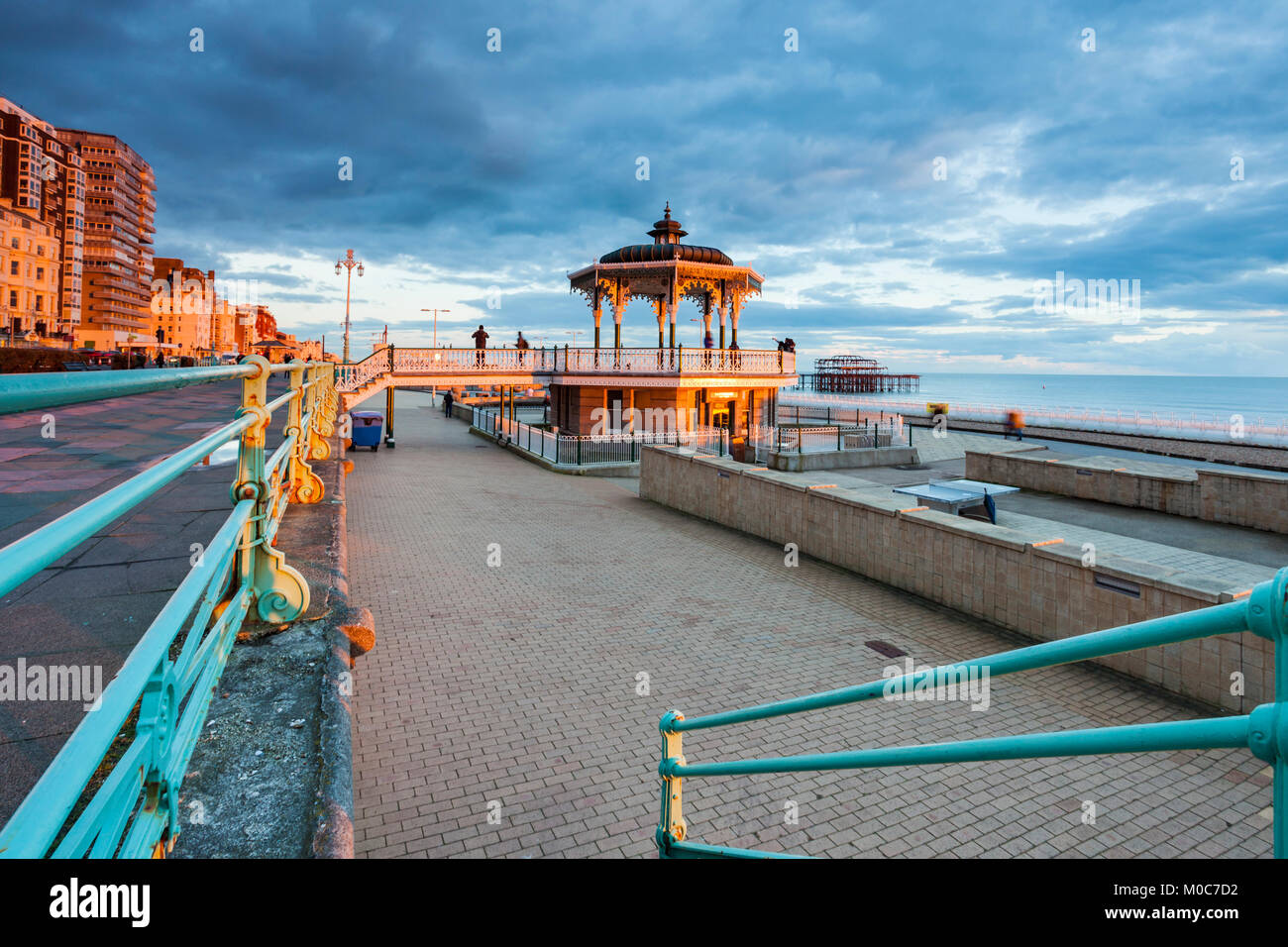 Sunset on Brighton seafront, East Sussex, England. The Bandstand in the distance. - Stock Image