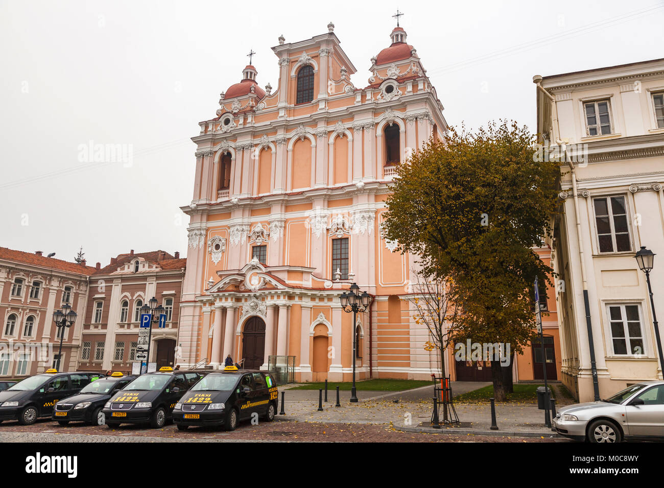 Colourful baroque Roman Catholic Church of St. Casimir, Vilnius Old Town, capital city of Lithuania, eastern Europe - Stock Image
