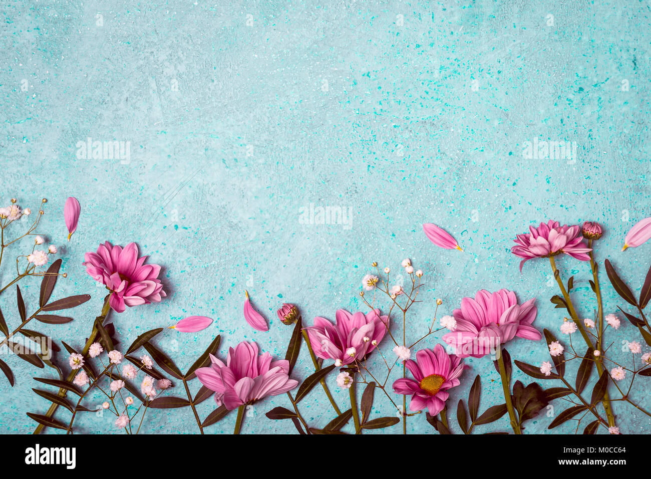 Spring summer creative nature background pink flowers border on spring summer creative nature background pink flowers border on vintage blue background mightylinksfo