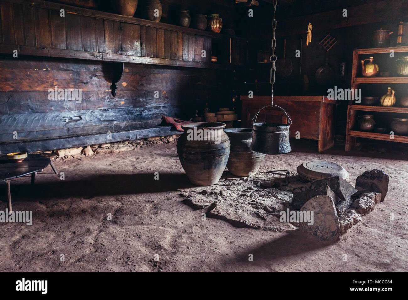 Earthen stove in traditional cottage in Ethnographic heritage park called Old Village Museum in Sirogojno village, - Stock Image