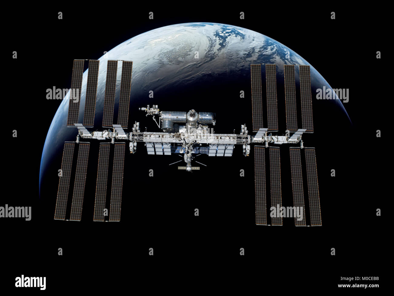 International Space Station over the planet earth. Elements of this image furnished by NASA. - Stock Image