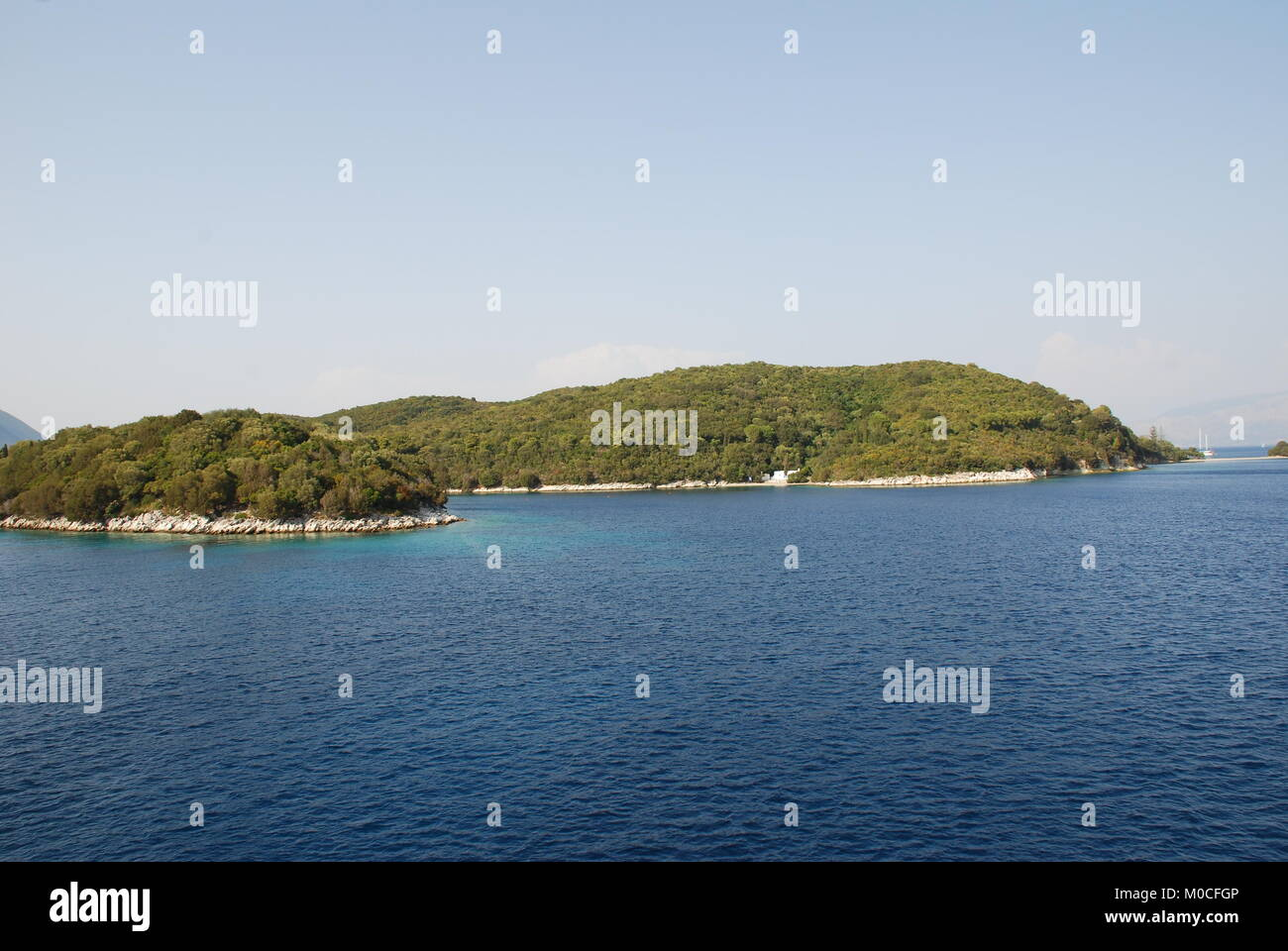 The small island of Skorpios off the coast of Lefkada, Greece. The island is the family home of the Onassis shipping - Stock Image