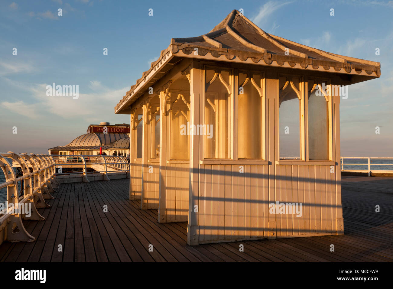 Sheltered seats on Cromer Pier, Norfolk, UK - Stock Image