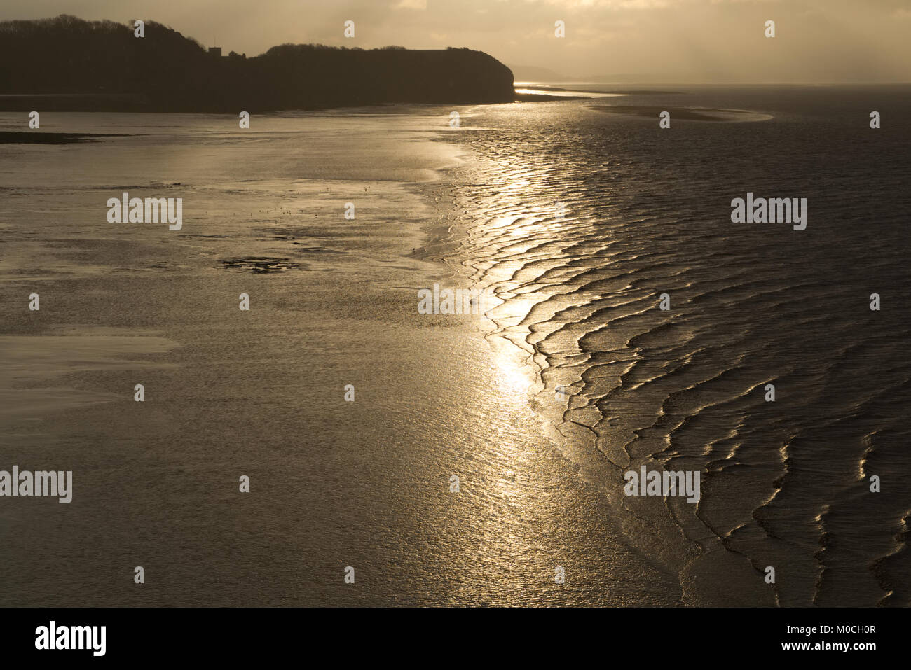 Waves lapping on the beach at sunset on Clevedon beach, Calm, relaxing, peaceful concept - Stock Image