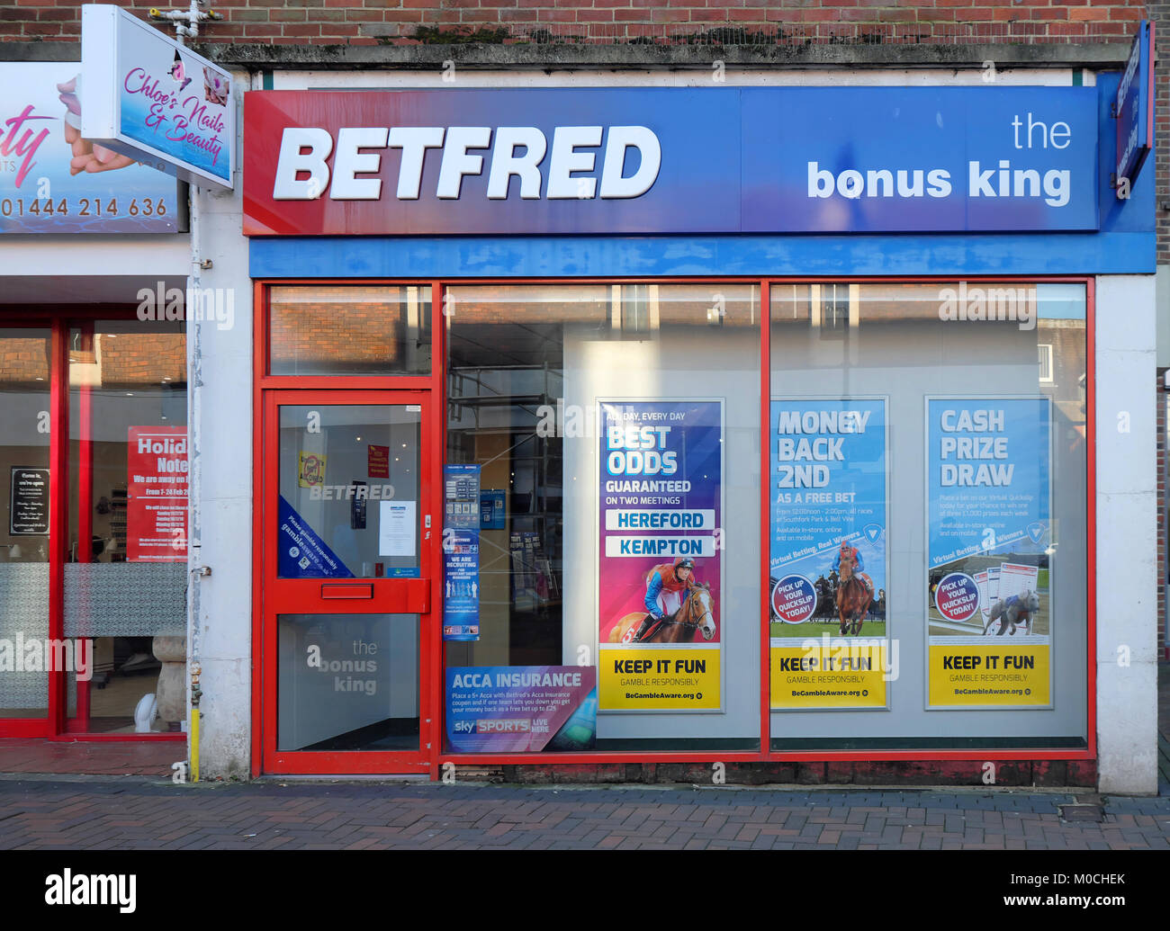 betfred betting shop in the church walk area of burgess that will be redeveloped starting in 2018 - Stock Image